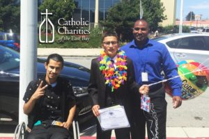 Javier Arongo (l) and Gimone Bryant (r) celebrate Abel's graduation from 8th Grade.