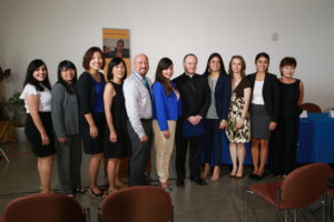 Members of the Oakland DACA/DAPA Project pose with Bishop Barber at Tuesday's press conference